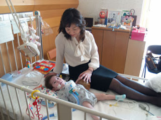 Image: Lawmaker Seiko Noda of the Liberal Democratic Party spends time with her son Masaki in a hospital. SEIKO NODA'S OFFICE / KYODO