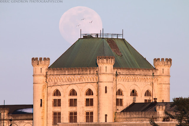 A full moon rises behind the naval prison