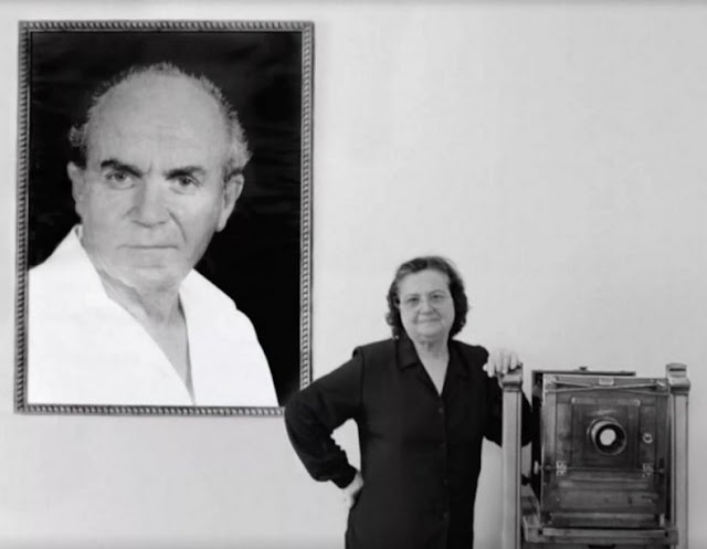 Drita Veseli in the picture with her husband's portrait Refik Veseli