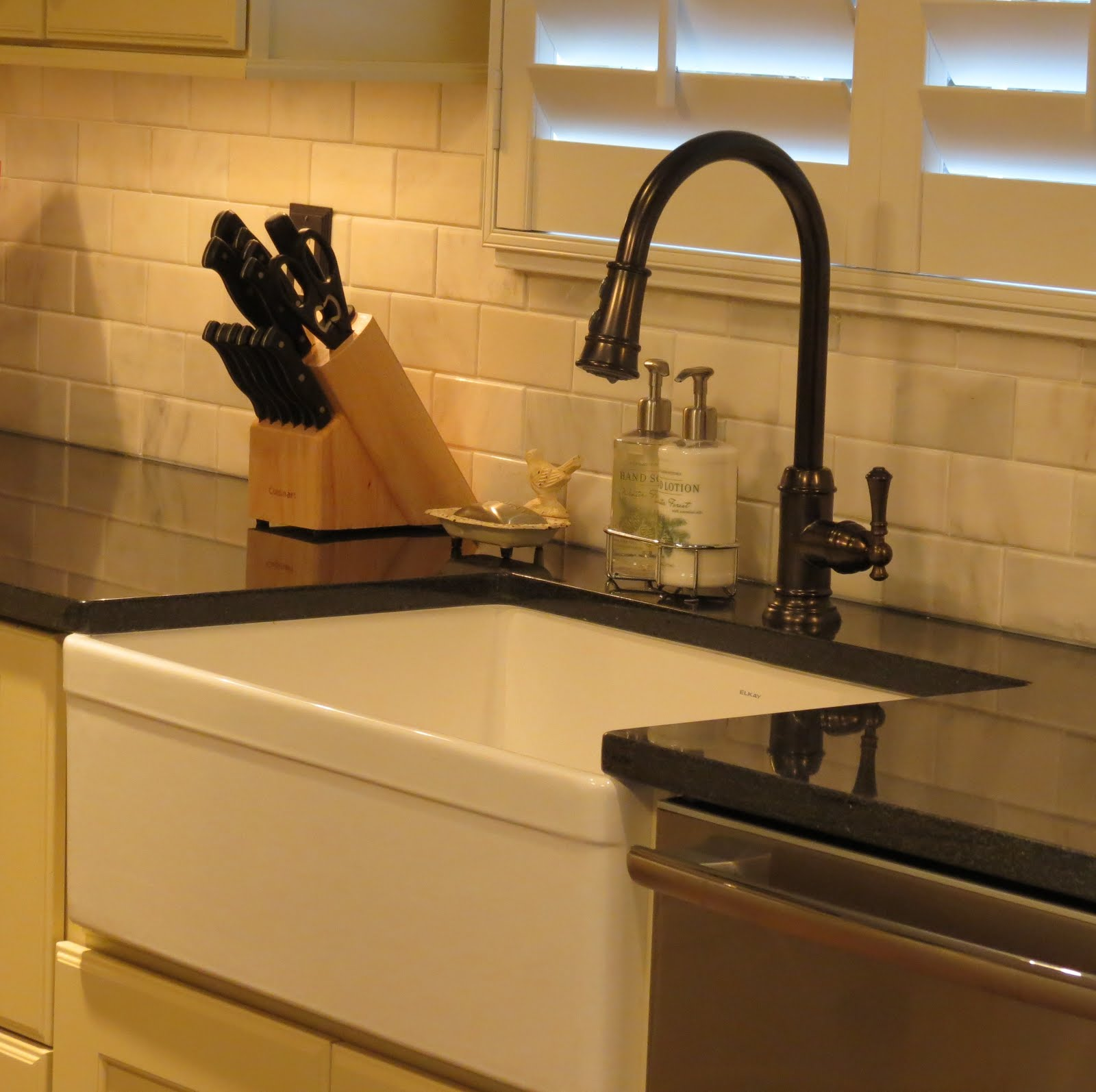 Black Stainless Steel Backsplash and Granite Countertops