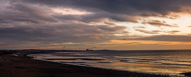 Photo of sunset over the shore at Maryport