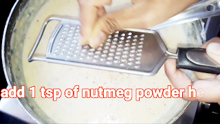 Image of adding nutmeg powder in the milk