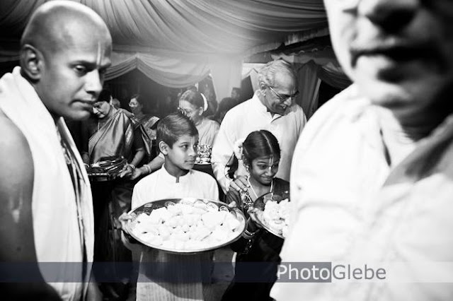 kids carrying tray in true emotion wedding