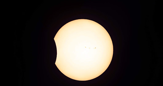 Partial Phase Eclipse with Sunspots