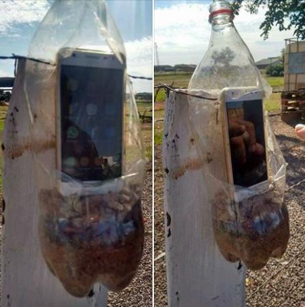 Quer ter um bom sinal móvel em áreas remotas? Coloque seu smartphone dentro de uma garrafa pet com areia e pedra.