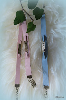 Lovelea's pink and pale blue Love bracelets