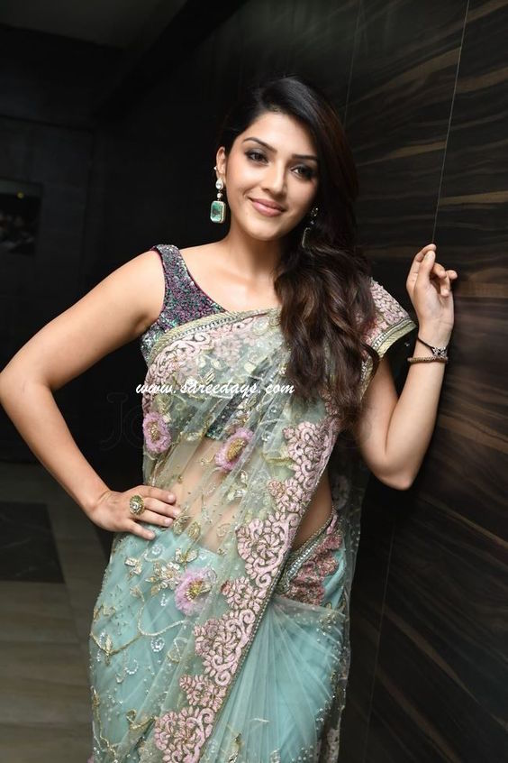 Latest saree designs green netted designer saree checkout green netted designer saree with rich work all over the saree and paired with matching sleeveless blouse altavistaventures Image collections