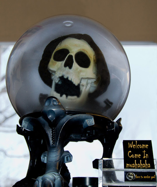 A skull inside a crystal ball sits on a customer service desk.