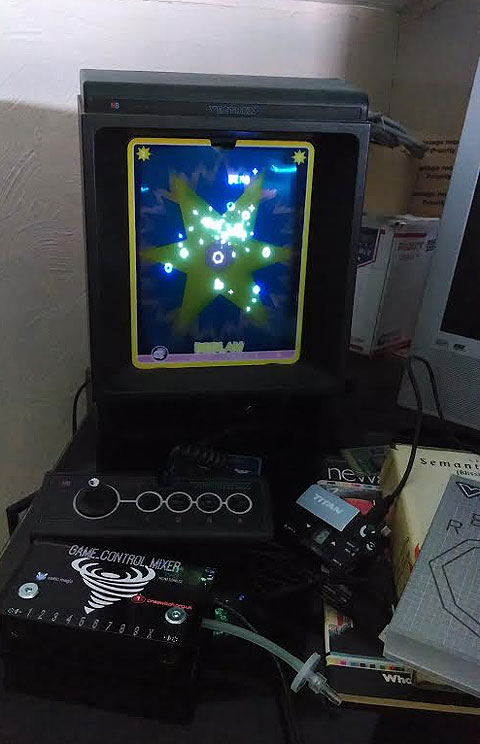 Image of a Vectrex playing the ones-switch game Release, Semantics, Game Control Mixer and Titan Two.