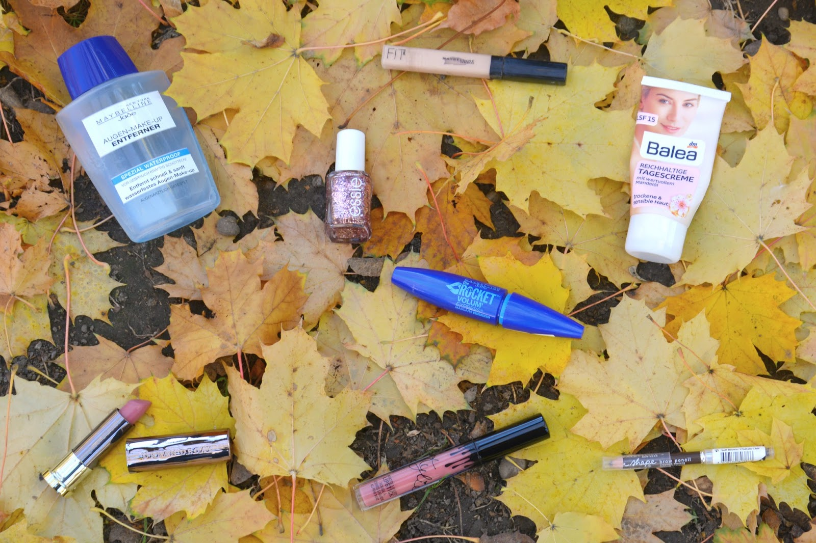 Maybelline Eye Makeup Remover, Balea Rich Day Creme, Maybelline Fit Me Concealer, Essie Nail Polish, Maybelline The Rocket Volum Express mascara, urban Decay Vice Lipstick, Kylie Liquid Lipstick on Autumnal leaves
