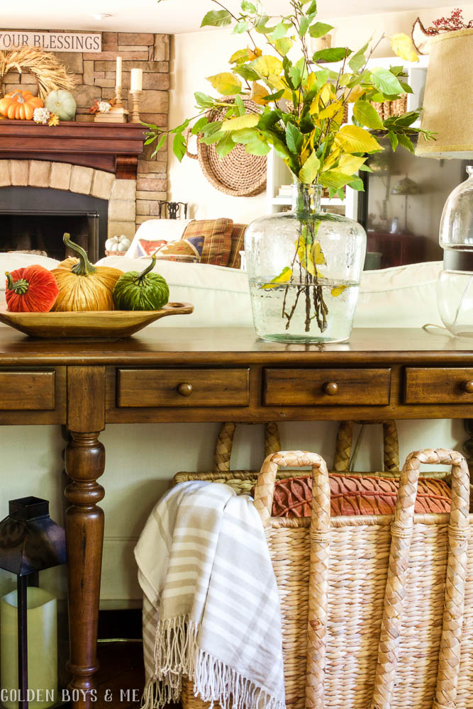 Pottery Barn console table with fall decor- velvet pumpkins and basket similar to Pottery Barn Beachcomber basket
