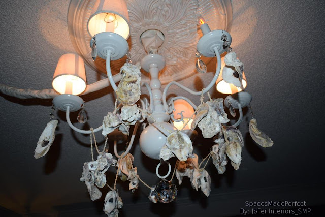 Chic,Thrifty,D.I.Y ideas for decorating a chandelier, using oyster shells and crystals
