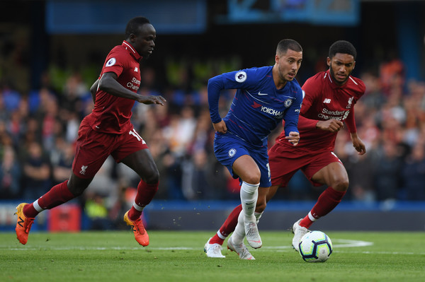 Eden Hazard of Chelsea breaks away from Sadio Mane and Joseph Gomez of Liverpool during the Premier League match between Chelsea FC and Liverpool FC at Stamford Bridge on September 29, 2018 in London, United Kingdom