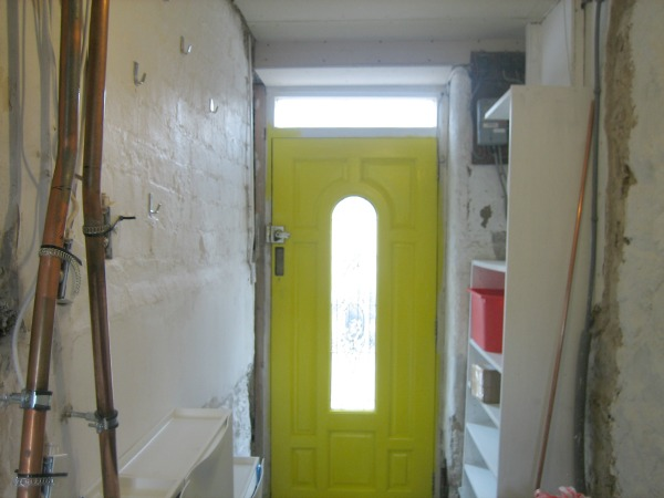 yellow door hallway renovation