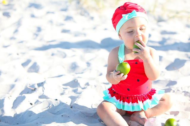 infant in watermelon bathing suit