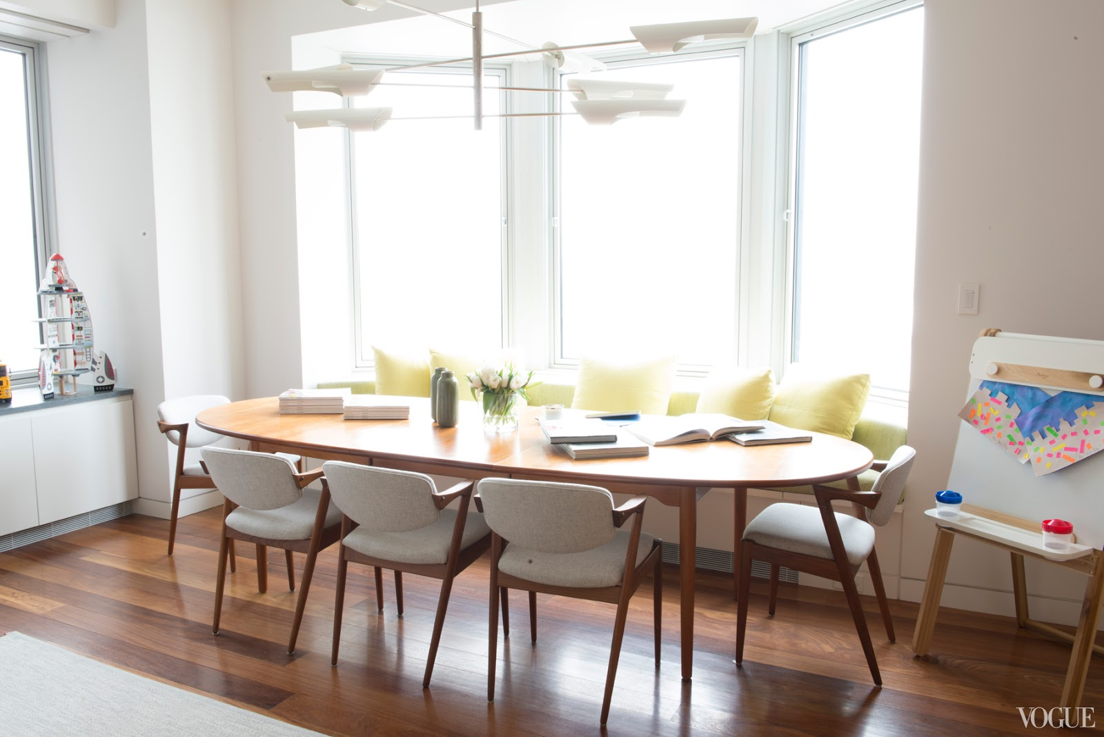 dining room oval table mid century modern david weeks chandelier lighting banquette bench window seating family room open floor plan cococozy