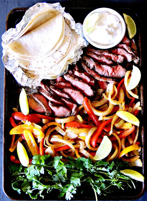 Sheet Pan Steak Fajitas are perfect for an easy weeknight meal! From www.bobbiskozykitchen.com