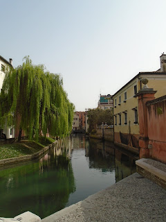Waterways lined with weeping willows are a common sight in Treviso