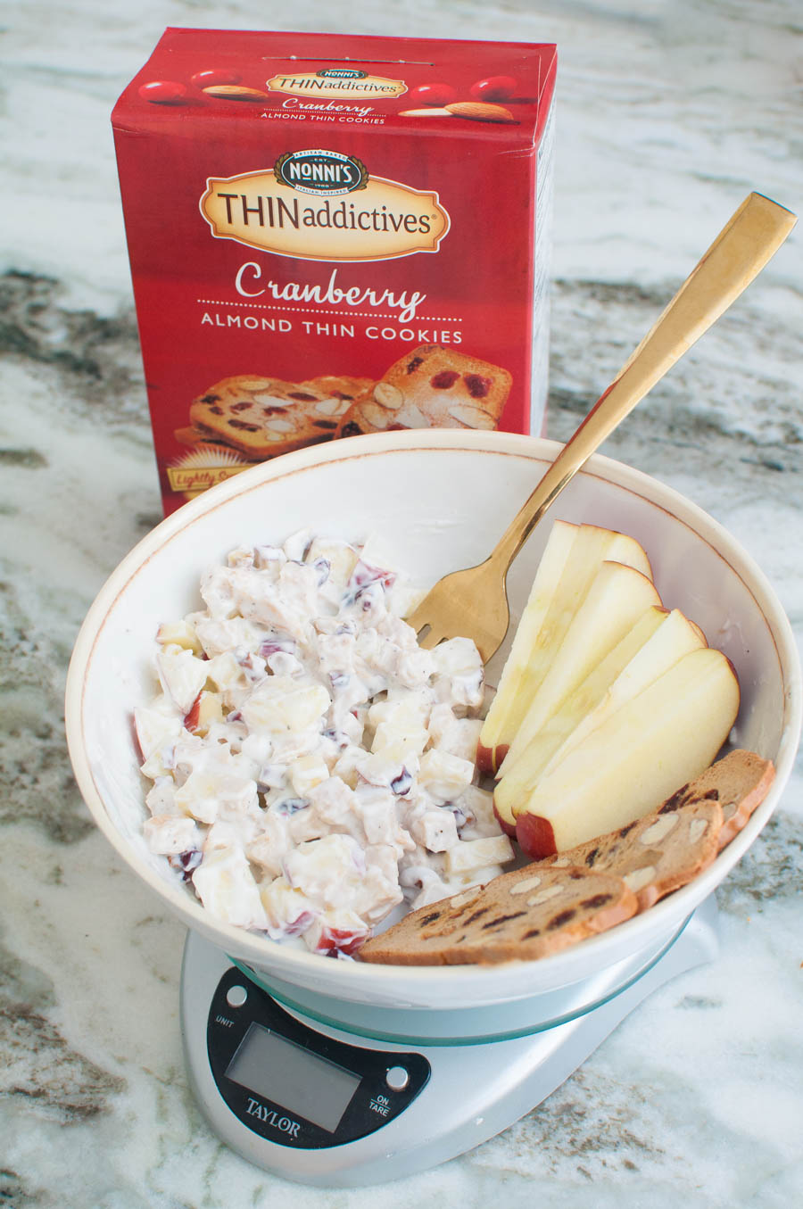 Chicken salad, apples, and Nonni's cranberry thins in a bowl.