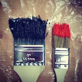 two used paint brushes on clingflim