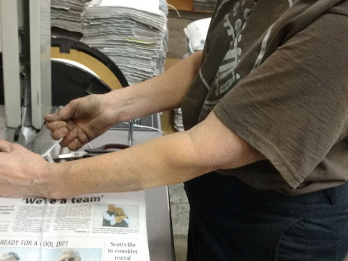 tying a bundle of newspapers