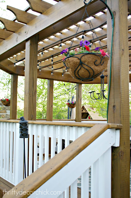 Pergola with hanging baskets and lights