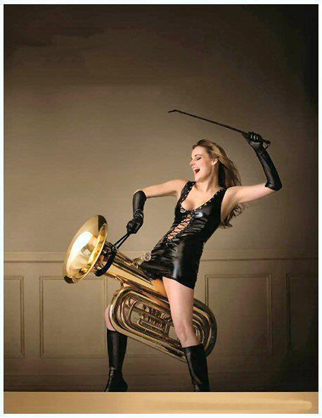 Woman in Leather Rides a Tuba