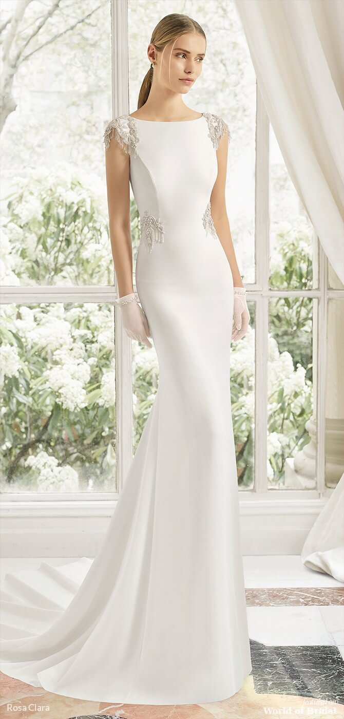643fdbb17555 This wonderfully draped crepe dress's elegance stems from its simplicity.  The spectacular jewelled back featuring frosted beading, fringing and a  sensual ...