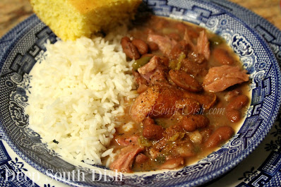 Made from scratch, dried red kidney beans made with a ham bone and the trinity and rice, both cooked in an instant pot electronic pressure cooker.