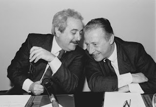 This famous picture of Falcone (left) and Borsellino, sharing a joke, was published by Time magazine