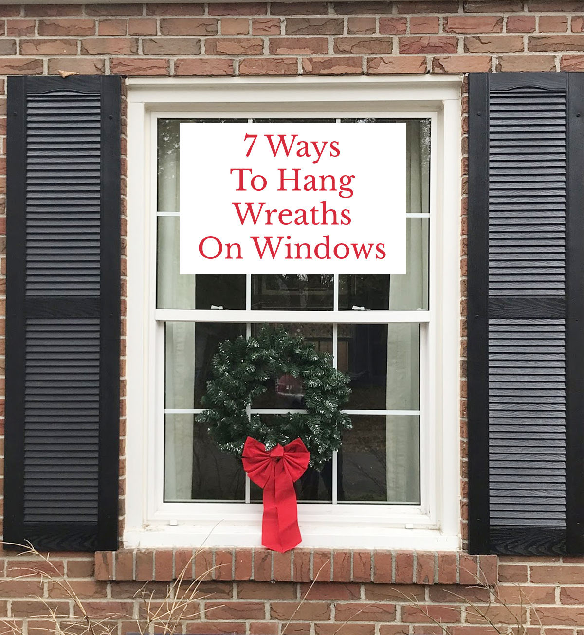 how to hang a wreath on outside windows | colonial house with wreaths
