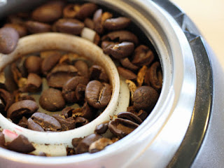 oily coffee beans clog grinder