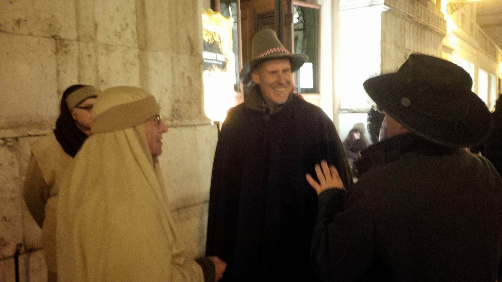 Comparing hats with some of the participants in the living Nativity Scene in Vicenza.