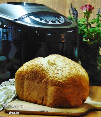 Máquina de fazer e cozer pão