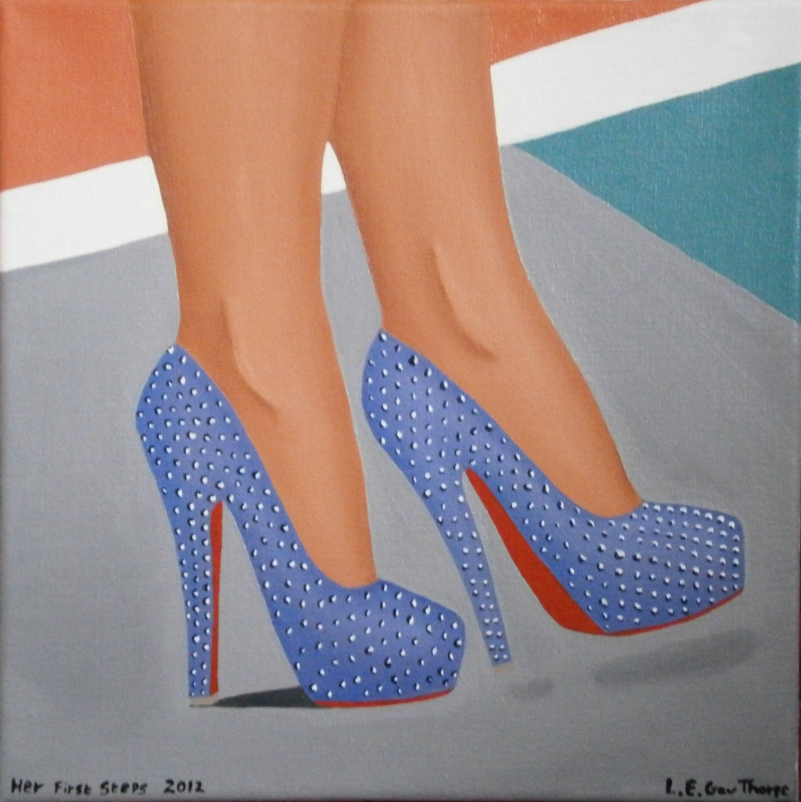 A woman wearing blue crystal encrusted high heeled shoes