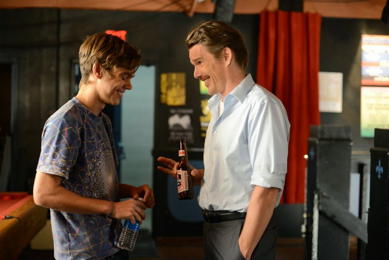 Mason Sr. (Ethan Hawke) shares a light moment with Mason Jr. (Ellar Coltrane) in Boyhood, Directed by Richard Linklater