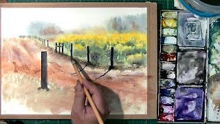 菜の花の水彩画を描いているところ