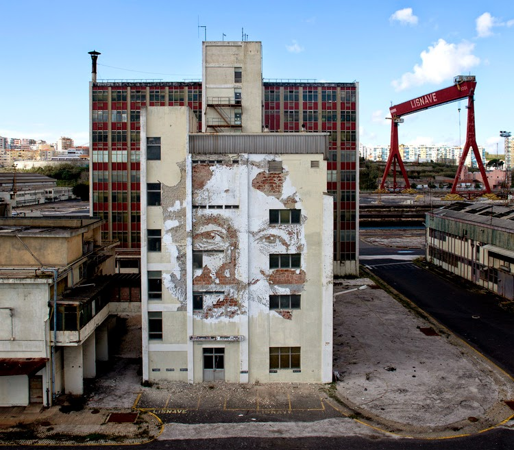 Vhils just sent us a series of sweet pictures from his newest piece which he just completed somewhere on the streets of Lisbon, Portugal.
