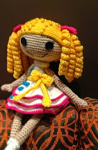http://www.ravelry.com/patterns/library/lala-doll-in-white-and-yellow