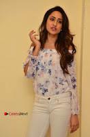 Actress Pragya Jaiswal Latest Pos in White Denim Jeans at Nakshatram Movie Teaser Launch  0064.JPG