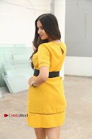 Actress Poojitha Stills in Yellow Short Dress at Darshakudu Movie Teaser Launch .COM 0313.JPG