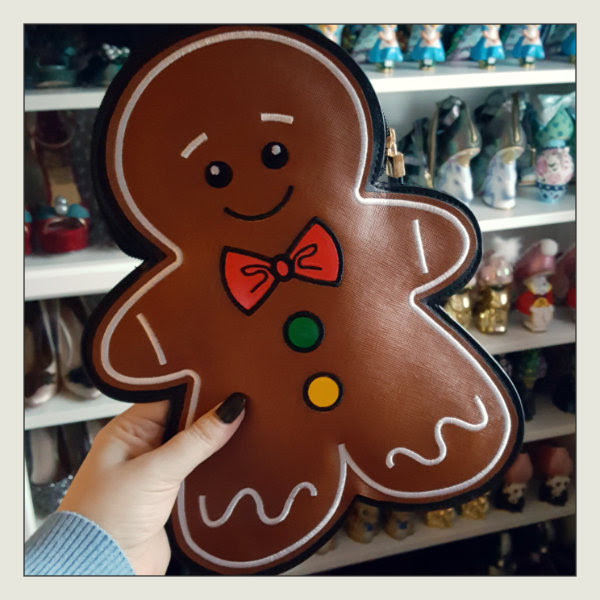 new look gingerbread man clutch bag