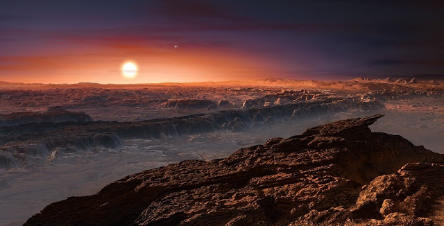 This artist's impression shows a view of the surface of the planet Proxima b orbiting the red dwarf star Proxima Centauri, the closest star to the Solar System. The double star Alpha Centauri AB also appears in the image. Proxima b is a little more massive than the Earth and orbits in the habitable zone around Proxima Centauri, where the temperature is suitable for liquid water to exist on its surface. Image & Caption Credit: ESO/M. Kornmesser