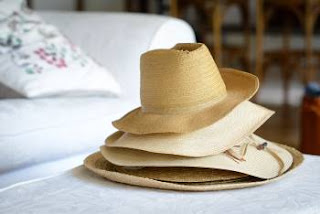 straw hats stacked
