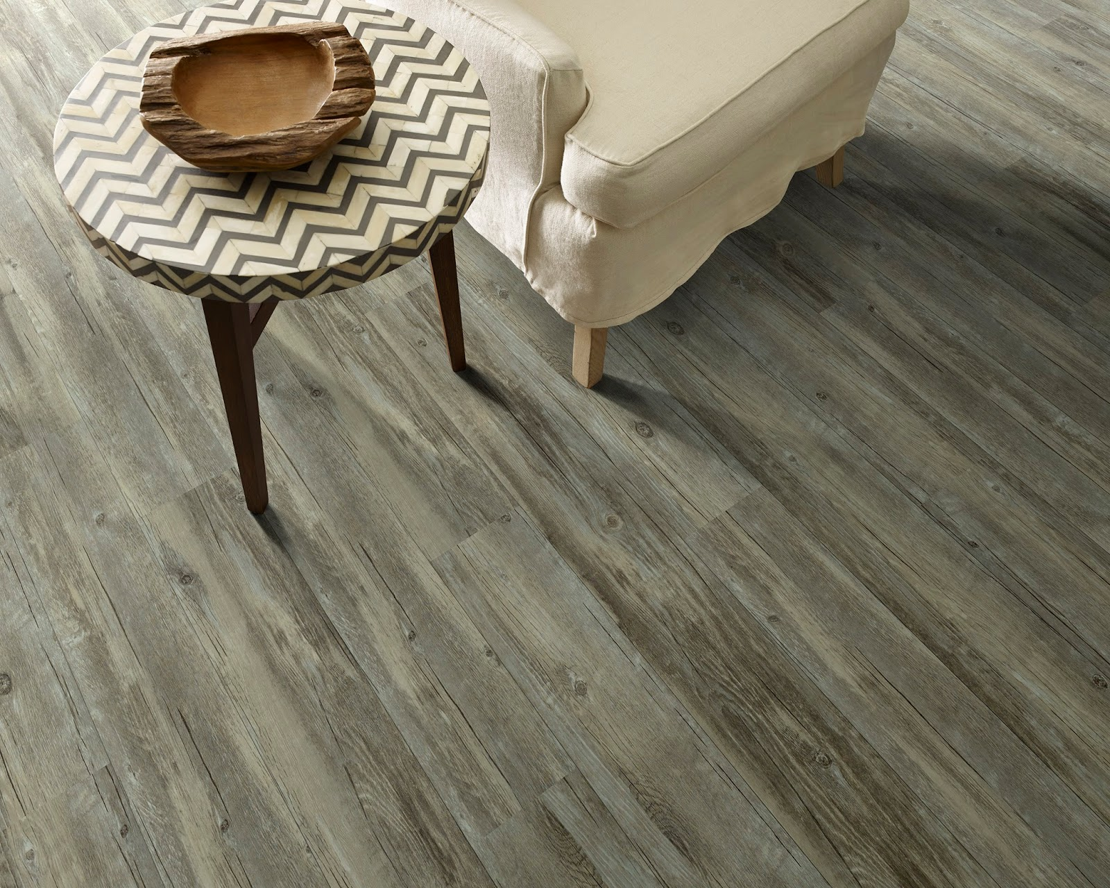 Is it hardwood or is it resilient flooring? The appearance is hard to tell apart!