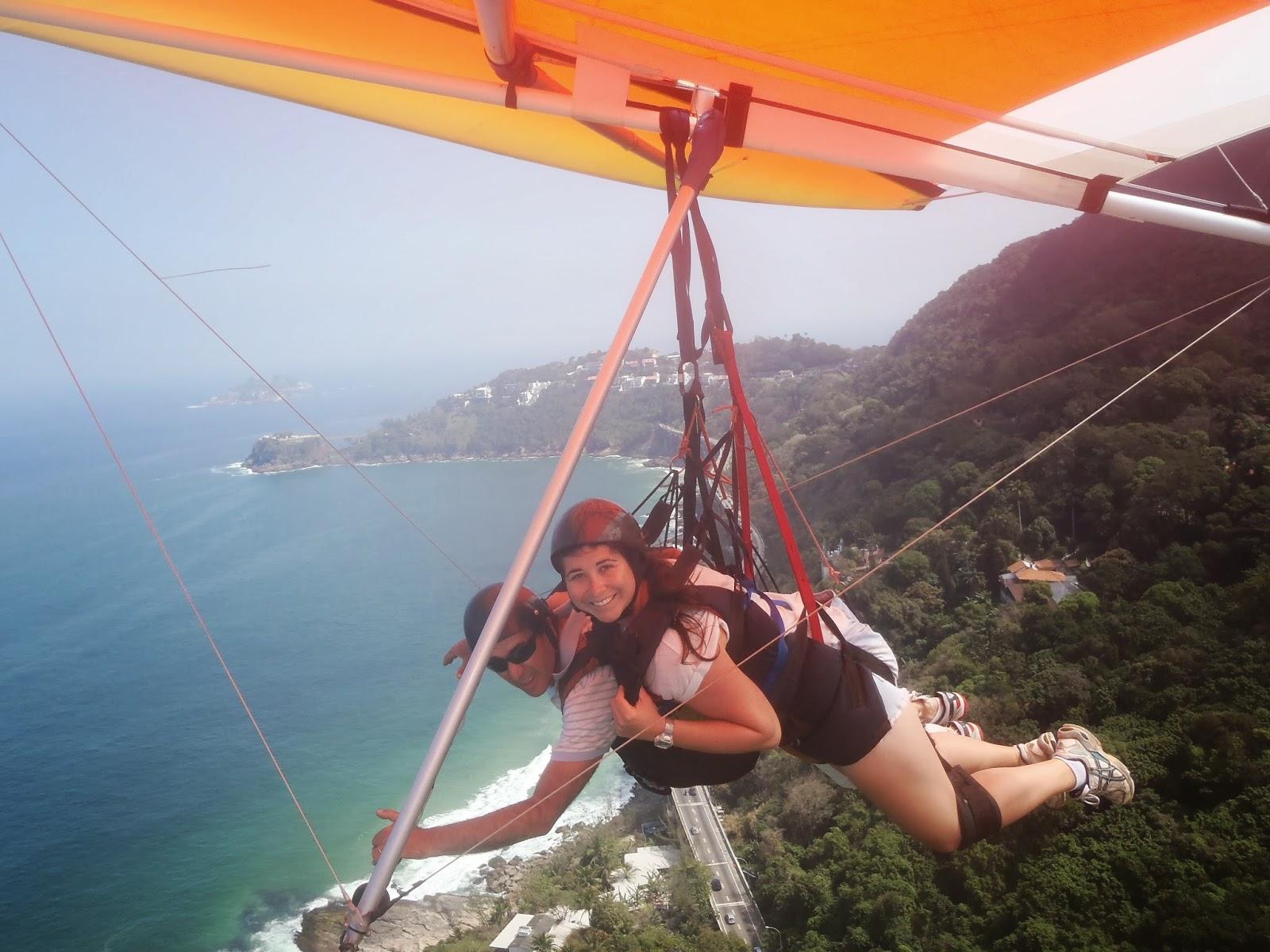 Girl hang gliding over Rio de Janeiro