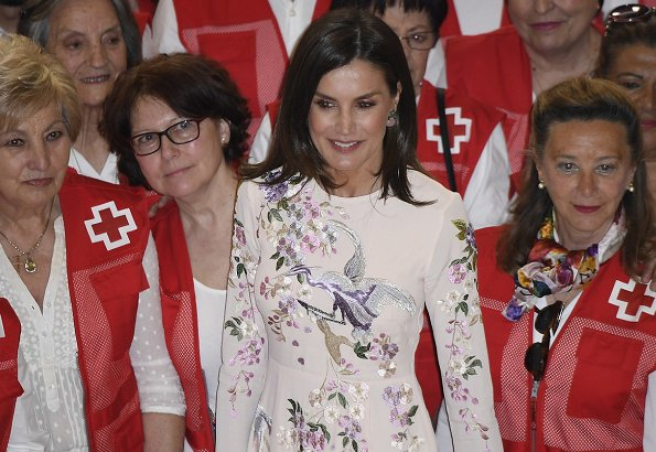 Queen Letizia wore a tall floral and bird embroidery midi dress by Asos Design. Letizia is wearing a Asos floral dress