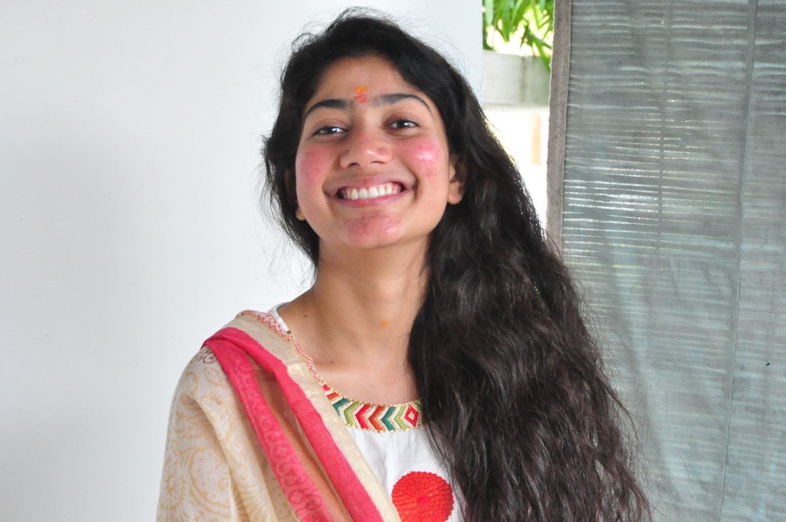 South Indian Actress Sai Pallavi Smiling Stills At Movie Launch In White Dress