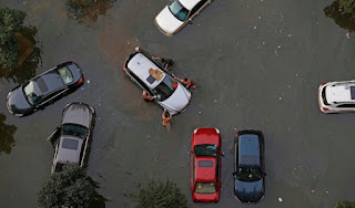 Vehicles are submerged in floodwaters on July 9, 2016 in Wuhan, Hubei Province of China. Many parts of the Wuhan area were submerged in floodwaters during July as torrential rains affected the Yangtze River valley. A new study finds that climate change increased the risk of the rains that led to the flooding by 17 – 59%. (Image credit: VCG/VCG via Getty Images) Click to Enlarge.