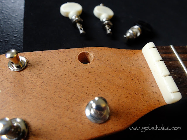 John Daniel ukulele headstock